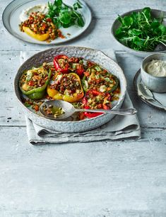 Hurrah for the stuffed pepper! Make this vegetarian classic shine brighter with cubes of halloumi, harissa and a whack of red chilli Veggie Recipes, Vegetarian Recipes, Cooking Recipes, Gf Recipes, Healthy Recipes, Halloumi, Spinach Stuffed Mushrooms, Stuffed Peppers, Corona