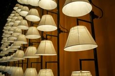 Must have a wall with lights and lamp shades like this. JUST LIKE THIS.