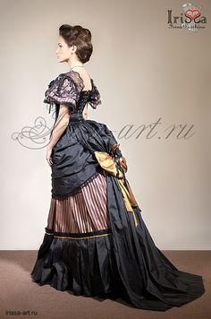 Now, you've got to admit...this is an absolutely gorgeous profile!  Sometimes I wish we could still wear these fashions today.  But I wouldn't want to have to wear the corsets necessary to achieve this look!