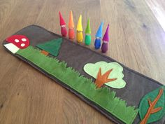 Woodland Roll Up and Play Mat,  with Rainbow Gnomes, Wool felt toy, felt toadstool, Waldorf  toy, Handmade  toy, play mat, by Gnomewerkspdx on Etsy https://www.etsy.com/listing/179227287/woodland-roll-up-and-play-mat-with