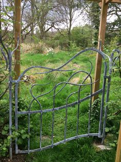 Organic garden gate hand forged and designed by blacksmiths at Gofannon forge in Mid Wales. Www.gofannonforge.com