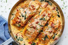 Creamy Garlic Tuscan Salmon With Spinach and Sun-Dried Tomatoes Smothered in a luscious garlic butter spinach and sun-dried tomato cream sauce, this Tuscan salmon recipe is so easy, quick, and simple. SERVINGS PREP: 10 MIN COOK: 20 MIN HOME / COOK Baked Salmon Recipes, Fish Recipes, Seafood Recipes, Chicken Recipes, Cooking Recipes, Recipes Dinner, Dinner Ideas, Keto Recipes, Recipe Chicken