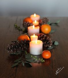 If an elaborate Thanksgiving table isn't exactly your cup of tea, take a cue from blogger Julie Blanner. In just five minutes, the blogger created a gorgeous and simple tablescape by arranging pillar candles, pinecones, clementines, and floral stems on her table. See more at Coordinately Yours.   - CountryLiving.com