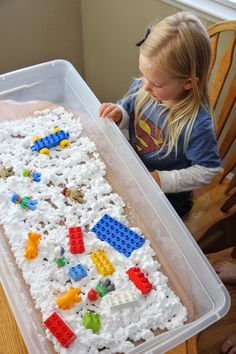 LEGO brick sensory bin. For toddlers whipped cream works the same as shaving cream.