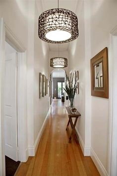 Repetition works very well in a long narrow space. Repetition works very well in a long narrow space. Repeat light fittings, picture frames, and furniture to draw the eye down the space. Narrow Hall Table, Hallway Ideas Entrance Narrow, Narrow Hallway Decorating, Narrow Entryway, Upstairs Hallway, Foyer Decorating, Decorating Ideas, Small Entry, Entrance Table