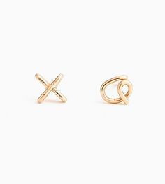 "One ""x"" and one ""o"" for romantic effect in gold fill or sterling silver."