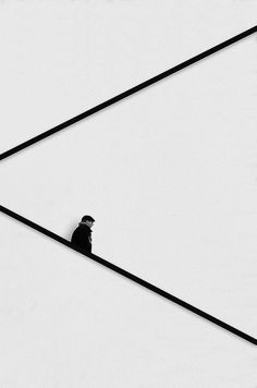 Black and white minimalism Man Walking Down The Stairs by Tom Cuppens.