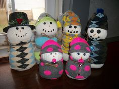Snowman families made with socks and rice