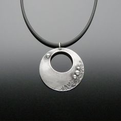 'Elysian Large Circle' Sterling Silver Pendant This divine Large Circle Pendant will make you feel like you're being transported to the Moon. #sterlingsilver #oneofakindjewelry #vivantedesigns #riojeweler
