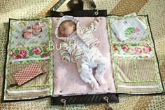 Bushka--This has got to be the greatest diaper bag ever! Pockets keep everything handy and organized, it opens so you have a place to change baby's diaper or even a place for baby to nap. Rather expensive at $198, but make your own for less than $35.00