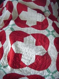 Antique tulip quilt - secondary design makes it hard to see tulips at first glance..you see the cross instead.