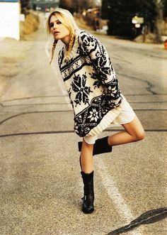 Big cozy sweater with pockets! :: looks darn cozy ( & I love her braids-n-boots ) ::