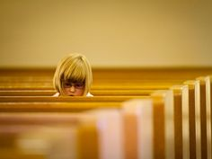 National Geographic - Photo of the Day • GIRL IN CHURCH PEWS A young girl at a wedding...