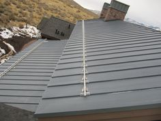 Ready to hold back tons of snow. Stainless steel snow abatement systems on zinc standing seam roof. www.copperexclusive.com