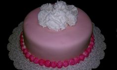 #wiltoncontest / A cake covered in fondant and using the flowers that we made in the class during course 3 in Hobby Lobby, Denton TX.