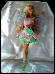 Coucou!! ça y est,c 'est dans la boîte comme dirait l'autre! Enfin, moi, c'est sur le pc et ma clef USB. Tout est noté. Donc, si vous aussi vous souhaitez crocheter cette tenue elfique pour miss Barbie, La méthode est simple: UN SIMPLE CLIC SUR LA PHOTO...