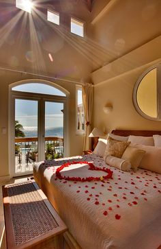 Belizian Cove Estates- Looks awesome. Its always romantic to see rose petals on a bed.