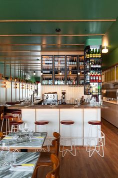 Ménard Dworkind recreates New York pizza restaurant in Montreal Pizzeria Design, Restaurant Design, Ikea Sinks, New York Pizza, Vintage Dining Chairs, Pine Walls, Oak Shelves, Pizza Restaurant, American Restaurant