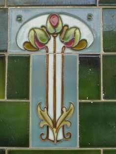 This beautiful stylised Art Nouveau rose bouquet tile appears on a shop front along Lygon Street in the Melbourne suburb of West Brunswick.