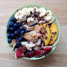 wow, big bowl of fruit with oatmeal - also looks like some peanuts, nut butter, and chocolate shavings?