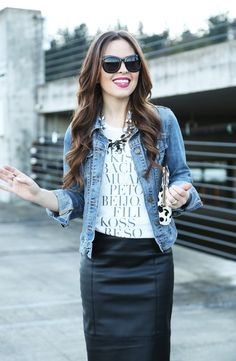 concert outfit.  graphic tee, leather skirt, denim jacket, bold lip