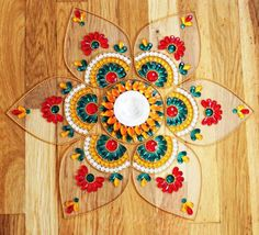 In this article we collect a top 27 Best Kundan Rangoli Designs for your Inspiration Easy Diwali Rangoli, Diya Rangoli, Indian Rangoli, Diwali Craft, Simple Rangoli, Diwali Diya, Diwali Gifts, Rangoli Colours, Rangoli Patterns