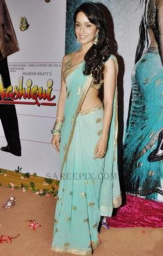 "Bollywood Saree: Shraddha Kapoor gorgeous in pastel saree and golden glitter saree choli, jhumka earrings, curled hair at ""Aashiqui music launch. Shraddha Kapoor Saree, Bollywood Saree, Indian Bollywood, Bollywood Fashion, Saree Fashion, Fashion Dresses, Beautiful Bollywood Actress, Beautiful Indian Actress, Indian Beauty Saree"