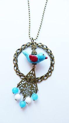 Sautoir sur chaine bille couleur bronze, oiseau filé au chalumeau, perles de jade, finitions bronze pièce unique