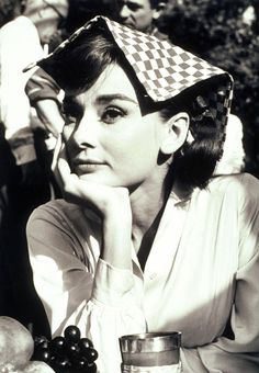 Audrey Hepburn - always classy. Even with a place-mat on her head.