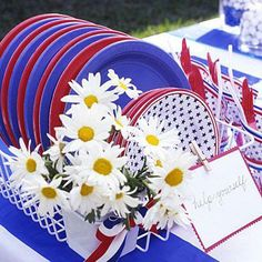 4th of July party ideas: Stop your paper plates from blowing away by putting them out in a dish rack.