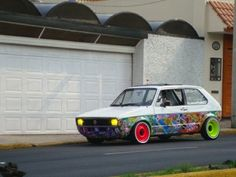 so.... I don't like this type of VW car at all, yet as a sticker bombed artwork it is very cool to look at.