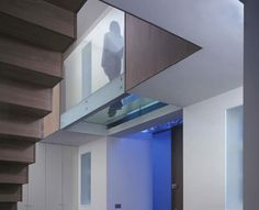 Staircase and Glass Walkway by Culmax, creates a sleek ultra modern effect