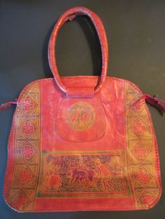 Vintage Leather Bag  Embossed Ethnic Bag  by handknitpalette, $18.00.  Beautiful colors.  This would make a nice carry-on.