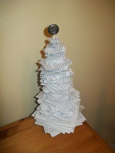 """""""Book page Christmas Tree craft."""" Make one with all the scratch paper I've used this semester. They're already green."""