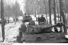 "1943 December  Kirovograd, Ukraine  Photos of Tiger S33 (foreground) and S13 of 8.Kompanie / ""Kampfgruppe Lammerding"" / SS-Panzer-Regiment 2/2.SS-Panzer-Division ""Das Reich""   These tanks played a less significant role in the German counterattack in the Zhitomir region, that suffered heavy casualties in the Battle of Kursk only a few months earlier.  Note  the ""Springender Teufel"" next to the turret.  Photo by Schnitzer Kriegsberichter"