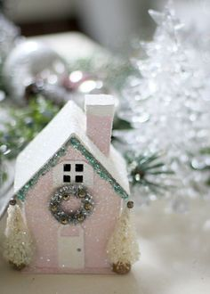 DIY:: Little pink house with pipe cleaner tinsel. You can buy these blank houses as http://www.scrapbook.com under the category of chipboard ornament houses
