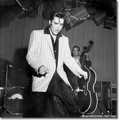 June 1956: There was a photographer for the teen magazines named Earl Leaf, and Earl mostly shot movie stars. The only two '50s rock 'n' roll sessions he's done were for Ricky Nelson, and he got to photograph Elvis at this 'Milton Berle Show' rehearsal. I think Earl Leaf's shots are just as good as Alfred Wertheimer's. You can see the complete intensity -- just riveting.