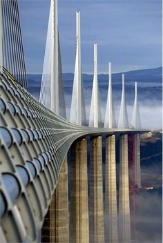 The Millau Viaduct is a cable-stayed bridge in southern France. Designed by French structural engineer Michel Virlogeux and British architect Norman Foster, it is the tallest bridge in the world with one mast's summit at 343.0 metres (1,125 ft) above the base of the structure. The bridge has been consistently ranked as one of the great engineering achievements of all time. The bridge received the 2006 International Association for Bridge and Structural Engineering Outstanding Structure…
