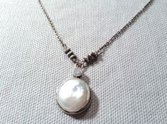 Handmade Sterling Bezel Set White Coin Pearl with White CZ accent on Sterling Necklace by J&I jewelry.