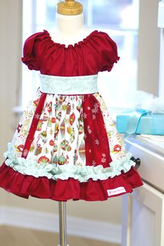 Baby Christmas Nicolle Peasant Dress available at Kinder Kouture Clothing.