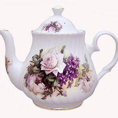 The tradition of afternoon tea comes alive with this bone china teapot imported from England. Inspired by a fragrant garden, this pattern features pale lavender roses and deep purple honeysuckle on a translucent white background. Made by Heirloom, this teapot has a 6 cup capacity and is elegantly trimmed in gold. Share a cup of tea with a special friend. It's tea time! #teapots Material: Bone China