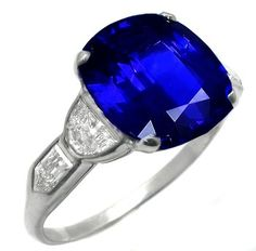 Art Deco platinum Ceylon Sapphire engagement ring. The ring is centered by a fabulous cushion cut Ceylon sapphire that weighs approximately 5.16ct. The sapphire is accentuated by sparkling half moon and bullete cut diamonds that weigh approximately 1ct. The color of the diamonds is F with VS1 clarity.