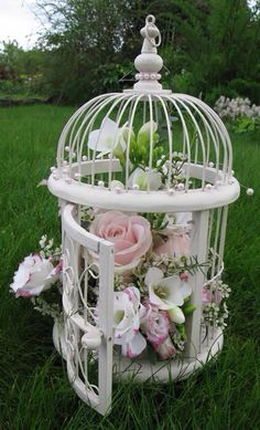 .Get my bird cage from Barb and plant a live houseplant in it and put some silk flowers and hang it in a corner. Might look good.