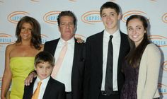 Frey poses for a photograph with his family