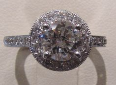My engagement ring. (Fiance's heirloom stone in a micropave antique-style halo setting)