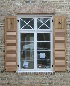 raised panel over louver cedar wood shutters with cutout