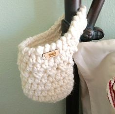 Fumbling for your glasses and phone in the middle of the night? Always losing your keys? If so, this free crochet pattern hanging basket is for you!