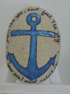 Authentic Lake Erie beach stone painted in nautical decor with Van Morrison lyrics.