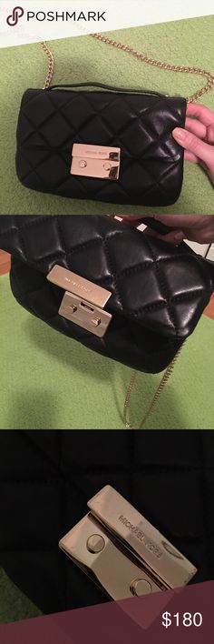 Michael kors bag Almost brand new, only used it for couple times. Images haven't been photoshop, reliable! Too much MK bags at home, I want to sell it for a considerable price. Black color is a easy color to matching close Michael Kors Bags Crossbody Bags