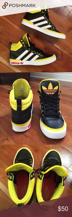 adidas hightop sneakers black and yellow with pink details and white stripes. lightly scuffed. great condition. worn a few times. size 11 in men's. bundle = discount. send an offer :) Adidas Shoes Sneakers